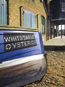 Oyster Boat Outside the Oyster Stores on the Seafront, Whitstable, Kent, England by David Hughes