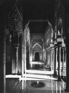 Magnificently Decorated Columns and Arches in an Arcade at the Alhambra Palace by David Lees