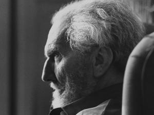 Poet Ezra Pound, 95, Relaxing in Wing Chair in Apt by David Lees