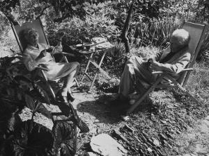 Poet Ezra Pound with Lover Olga Rudge, Chatting in Lounge Chairs Next to Breakfast Food in Garden by David Lees