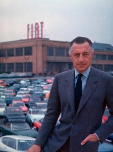 President of Fiat Gianni Agnelli Standing with Cars and Fiat Factory in Background by David Lees