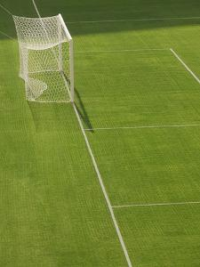 Goal and Net on Empty Soccer Field by David Madison