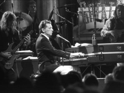 """Singer Jerry Lee Lewis Performing at Party for Film """"Great Balls of Fire,"""" Based on His Life Story"""