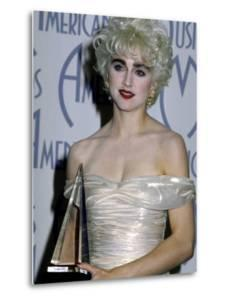 Singer Madonna Holding Her Award in Press Room at American Music Awards by David Mcgough