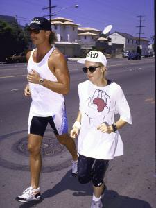 Singer Madonna Jogging with Trainer by David Mcgough