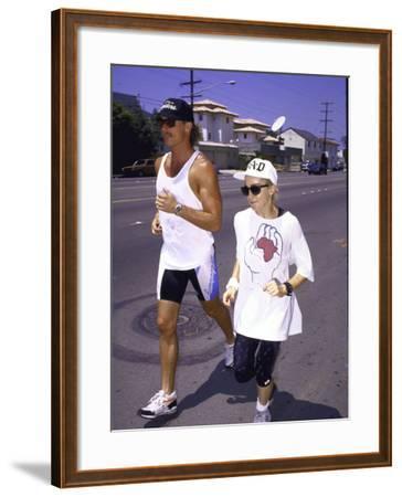 Singer Madonna Jogging with Trainer
