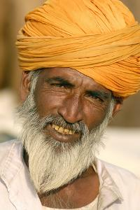 A Camel Breeder at the Pushkar Camel Fair, Rajasthan, Pushkar, India by David Noyes