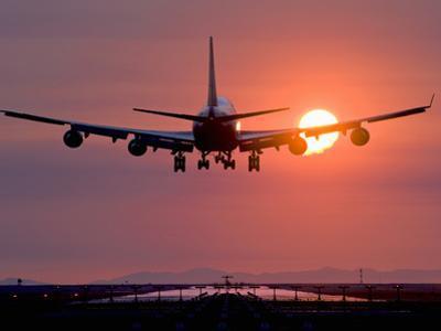 Boeing 747 Landing at Sunset, Vancouver International Airport, British Columbia, Canada by David Nunuk