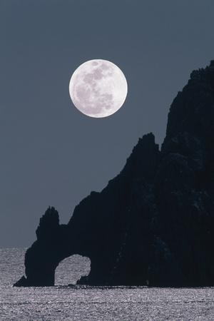 Full Moon Rising Over a Coastal Cliff
