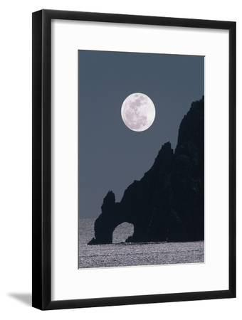 Full Moon Rising Over a Coastal Cliff