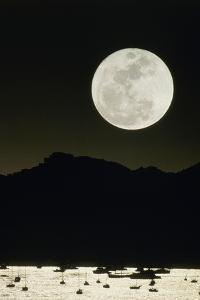 Full Moon Seen From Earth Over Mountains by David Nunuk