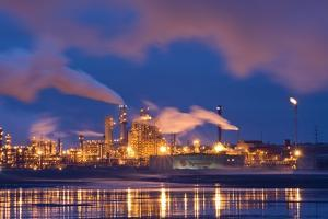 Oil Refinery At Night by David Nunuk