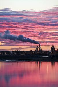 Oil Refinery At Sunset by David Nunuk