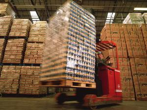 Fork-lift Truck In Warehouse by David Parker