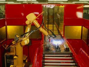 Industrial Robot Welding on Production Line by David Parker