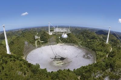 Upgraded Arecibo Radio Telescope with Subreflector
