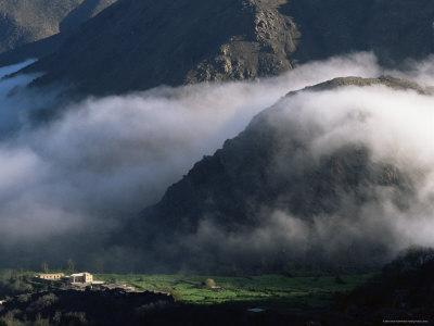 Local School Below Mist Rising in Valley of the High Atlas Mountains, Morocco, North Africa, Africa