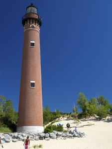 The Little Sable Point Light on Lake Michigan in Golden Township, Michigan, USA by David R^ Frazier