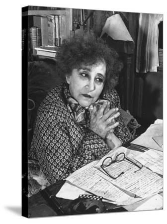 French Novelist Colette, at Desk Covered with Handwritten Notes Topped by Reading Glasses at Home