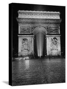 View of the Arc de Triomphe Lit at Night on Bastille Day by David Scherman