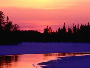Partly Frozen River Near Arctic Circle, Kuusamo, Finland by David Tipling