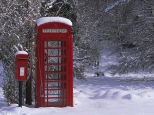 Red Letterbox and Telephone Box in the Snow, Highlands, Scotland, UK, Europe by David Tipling