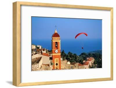 Paraglider Soaring past Tower of Colourful Village Church, Alpes-Maritimes, Roquebrune, Provence-Al
