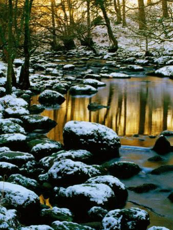 River Rathay at Grasmere with Winter Snow on Rocks, Lake District National Park, Cumbria, England by David Tomlinson