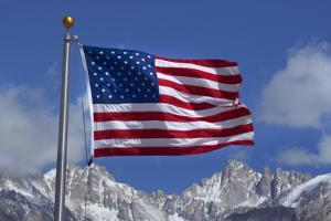 American Flag and Snow on Sierra Nevada Mountains, California, USA by David Wall
