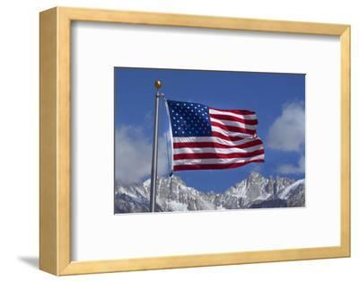 American Flag and Snow on Sierra Nevada Mountains, California, USA