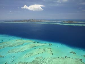 Malolo Barrier Reef and Malolo Island, Mamanuca Islands, Fiji by David Wall
