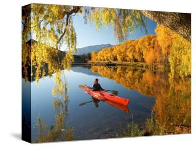 Red Kayak and Autumn Colours, Lake Benmore, South Island, New Zealand