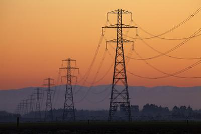 Row of Power Pylons at Sunset, Mid Canterbury, South Island, New Zealand by David Wall
