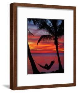 Woman in Hammock, and Palm Trees at Sunset, Coral Coast, Viti Levu, Fiji, South Pacific by David Wall