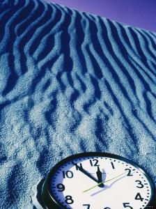 Clock Reading 11:55 Pm in the Sand by David Wasserman