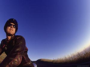 Man on Motorcycle by David Wasserman