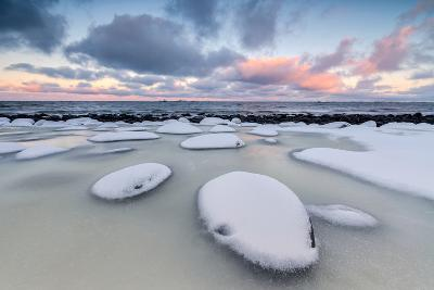 Dawn on the Cold Sea Surrounded by Snowy Rocks Shaped by Wind and Ice at Eggum-Roberto Moiola-Photographic Print
