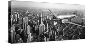 DC-4 over Manhattan, NYC