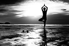 Silhouette Young Woman Practicing Yoga on the Beach at Sunset-De Visu-Photographic Print