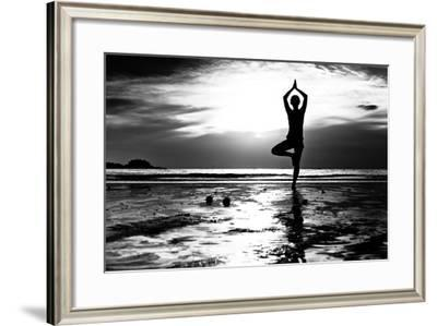 Black And White Picture: Young Woman Practicing Yoga On The Beach At Sunset