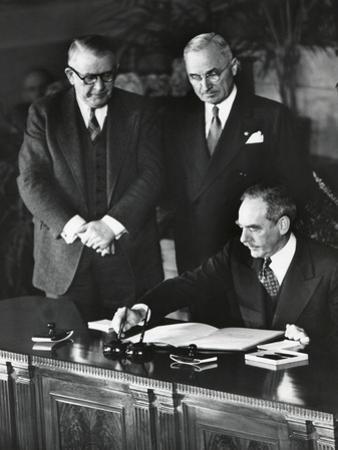 Dean Acheson, Sec. of State, Signs the North Atlantic Treaty Establishing the Nato Alliance