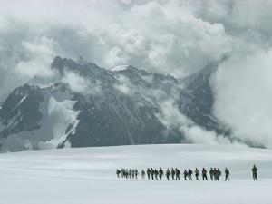 Hikers on a Snowfield Near Mount Elbrus by Dean Conger
