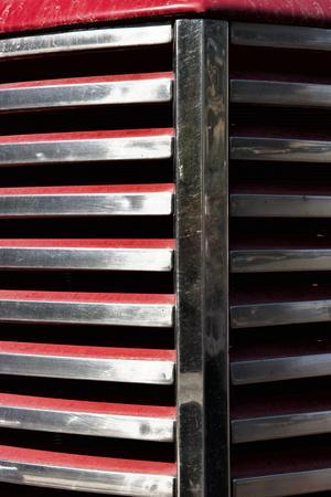 USA, Palouse, Washington State. Chrome grille on a red antique truck in the Palouse.