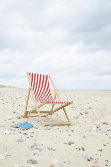 Deck Chair with Book on Sand at Beach.-Dougal Waters-Photographic Print