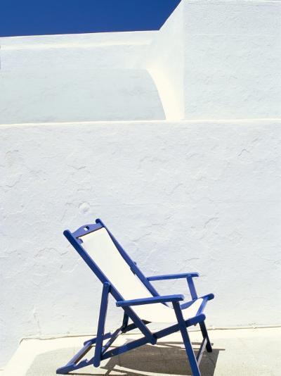Deckchair Against Whitewashed Wall, Imerovigli, Santorini (Thira), Cyclades Islands, Greece-Lee Frost-Photographic Print