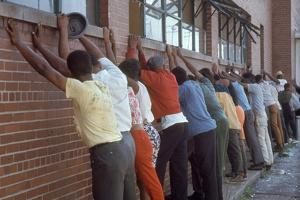 Africans American Lined Up Against Wall Being Arrested by Police after Race Riots in Detroit, 1967 by Declan Haun