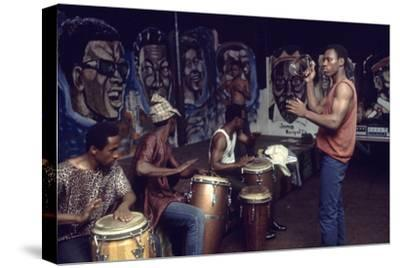 Members from 'The Blackstone Rangers' Gang Drumming in their Hang Out, Chicago, IL, 1968