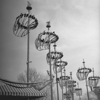 Decorations on Poles-George Marks-Photographic Print