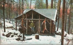 Deer Hanging by Rustic Cabin in Winter