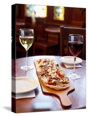 Delicious Italian Pizza and Wine on Table